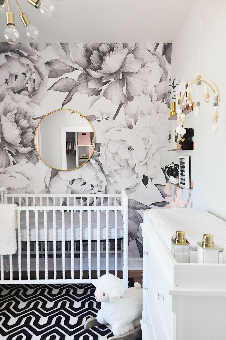 Modern black, white, and gold nursery with graphic floral print
