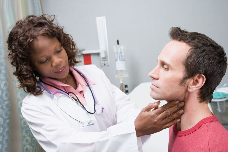 Doctor feels the lymph nodes in a patient's neck