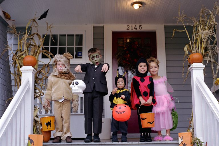 Children on porch on Halloween