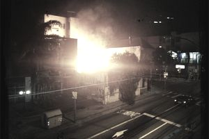 Burning building at night