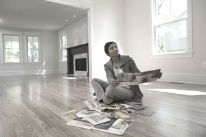 A woman surrounded by brochures in an empty house