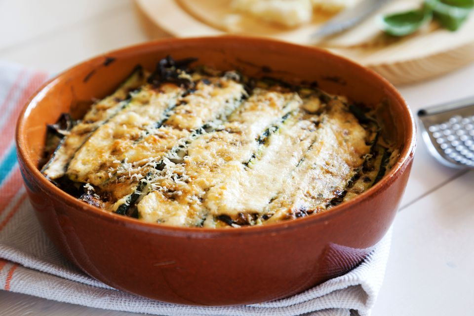 traditional italian recipe of parmigiana di zucchini baked