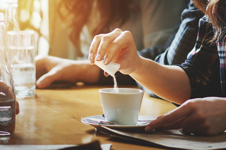Adding artificial sweetener to coffee