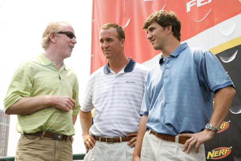Archie Manning talks to sons quarterbacks Peyton Manning and Eli Manning