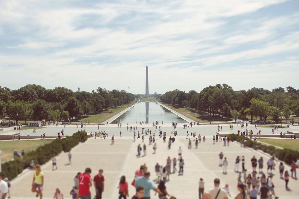 Tourists Visiting World War Ii Memorial Against Sky