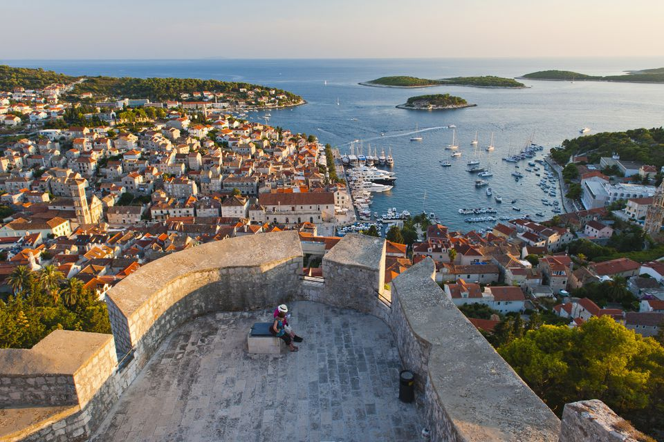 Hvar Town and tourists at Hvar Spanish Fort (Fortica) at sunset, Hvar Island, Dalmatian Coast, Adriatic, Croatia, Europe