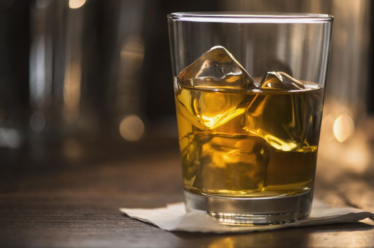 glass of scotch on bar