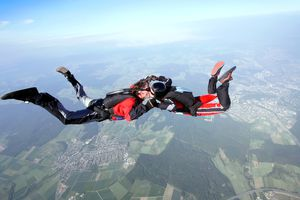 Skydiver couple enjoy kissing in free fall