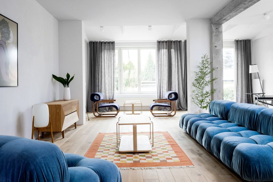 minimalist living room with blue sofas