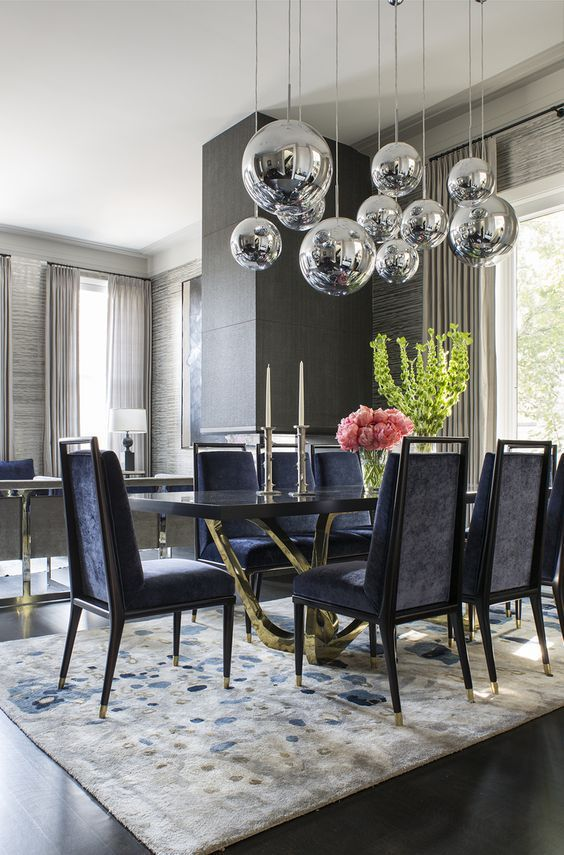 Gray Dining Room With Modern Lighting