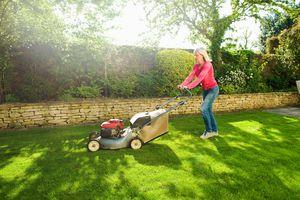 woman mowing a lawn