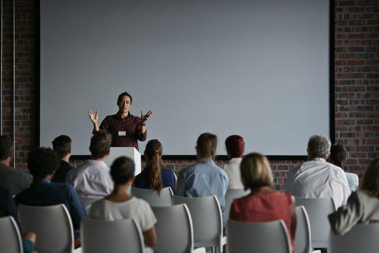 Businessman doing a presentation at big convention