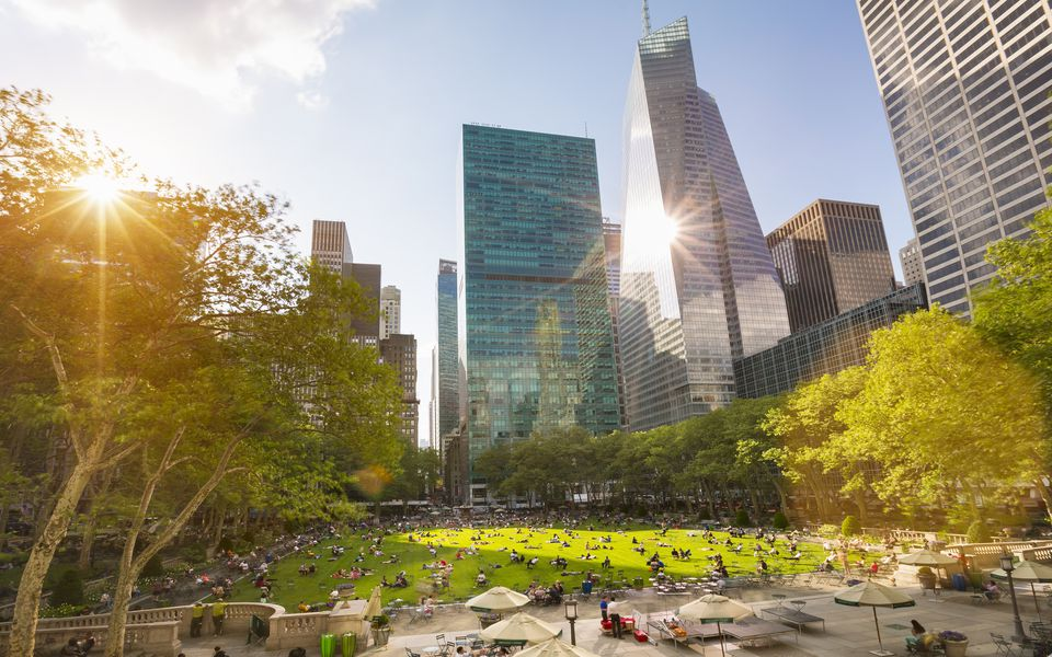 Crowds in Central Park and city skyline, New York, USA