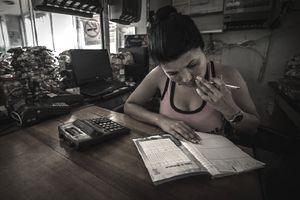 Woman with a planner and calculator