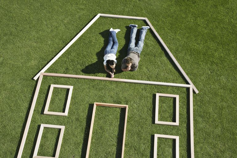 Couple laying inside house outline