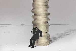 Man fearfully protecting stack of coins