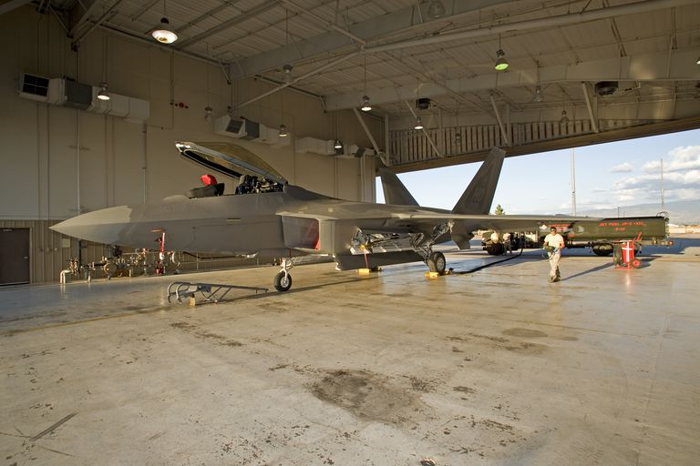 Maintence personnel from the 49th Fighter Wing at Holloman Air Force Base, New Mexico, prepare to refuel an F-22 Raptor.