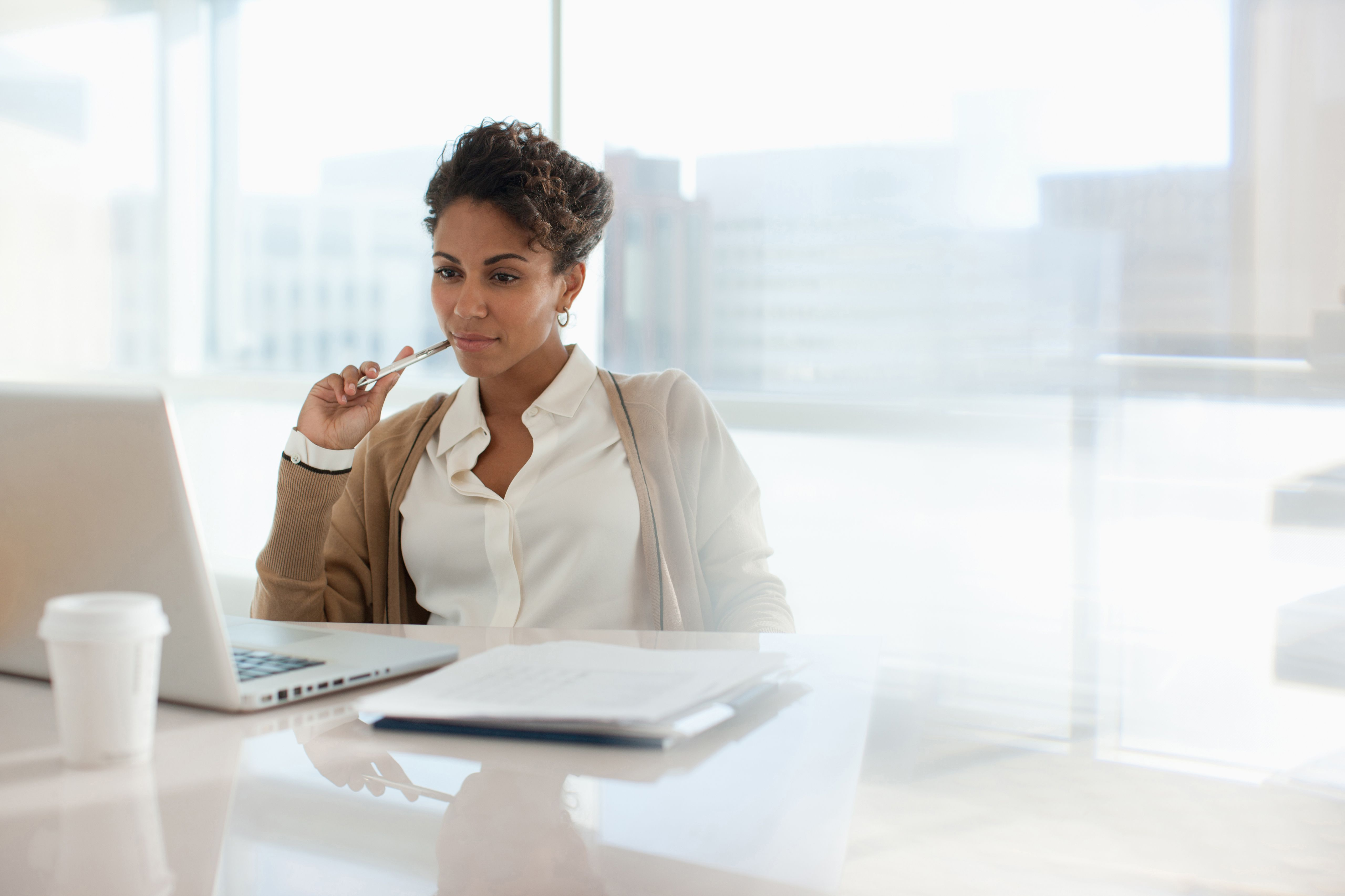 Cover letters businesswoman using laptop in office madrichimfo Gallery
