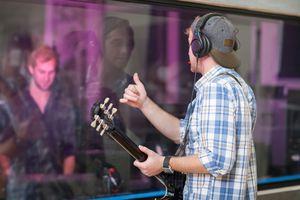 Guitarist in recording studio