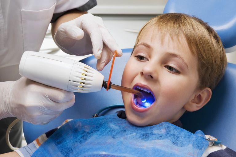 Dentist examining a boy's teeth