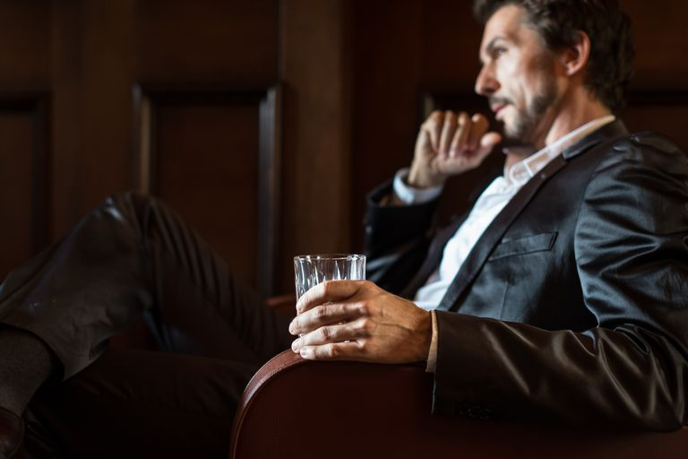 Mature Man Holding Whiskey Glass
