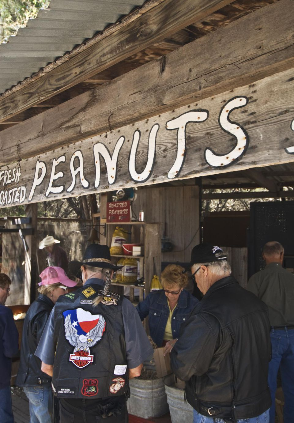 Roasted peanut vendor and customers at Wimberley Market