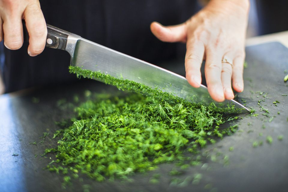 Cutting herbs with chef's knife