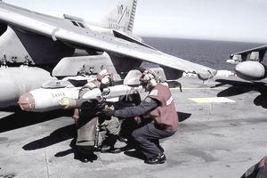 Navy And Marine Corps Aviation Ordnancemen Load Ordnance Onto An Av 8B Harrier Aboard The Landing