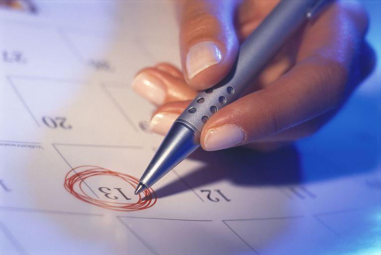 woman circling date on calendar
