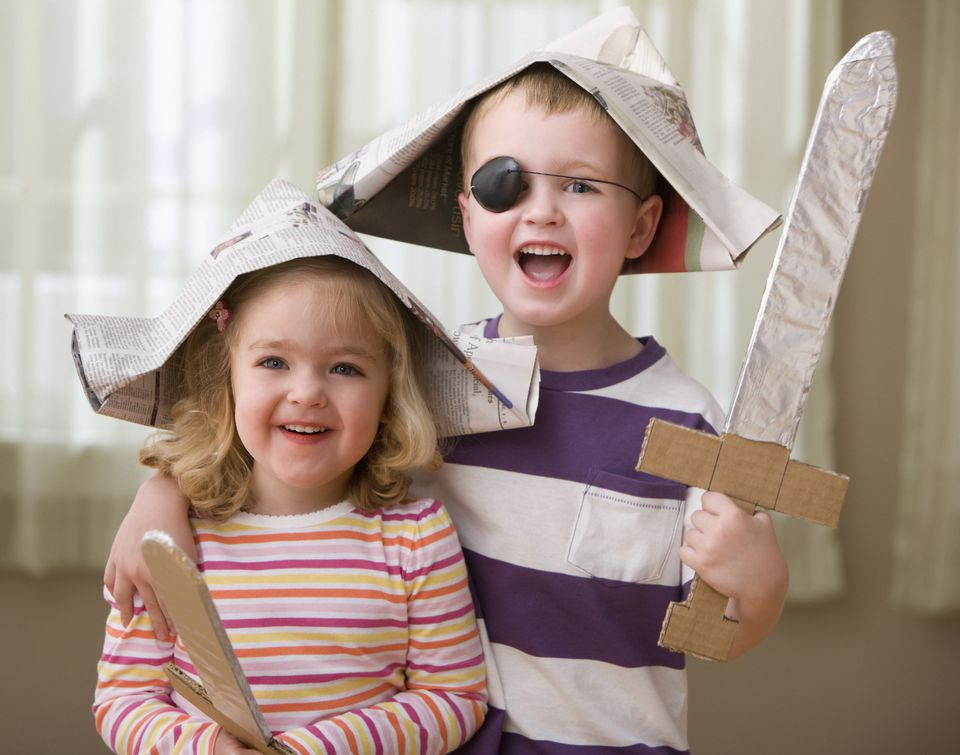 young brother and sister wearing paper pirate hats