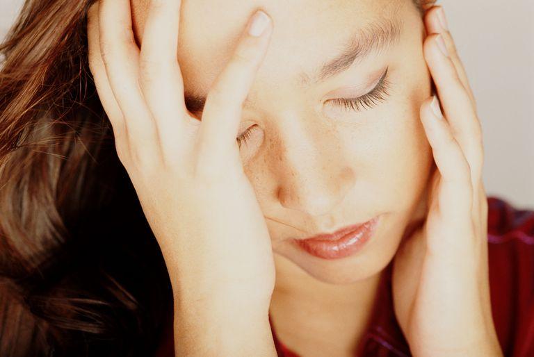 Woman experiencing fatigue.