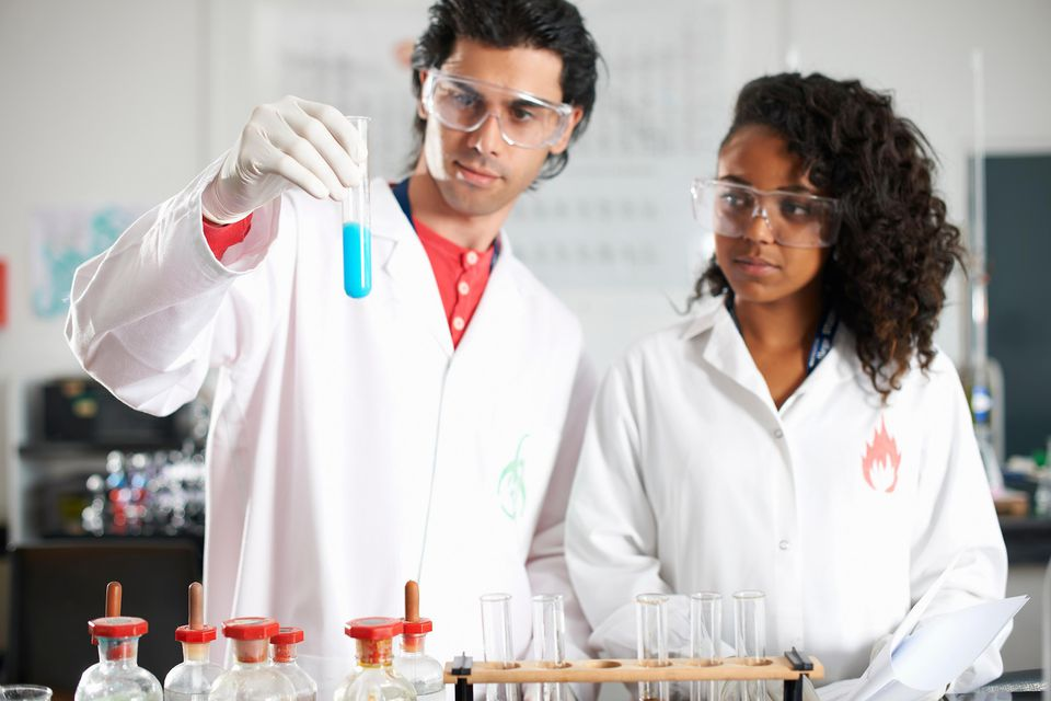 Two chemistry students doing experiment