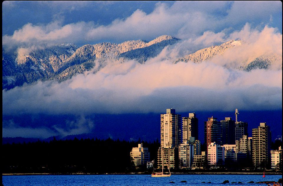 West End skyline with snowy mountains in the background, Vancouver, BC