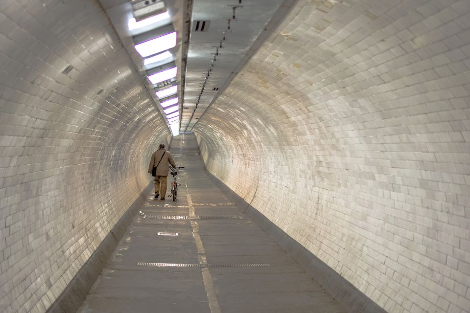 Rear View Of Man With Bicycle Walking At Greenwich Foot Tunnel