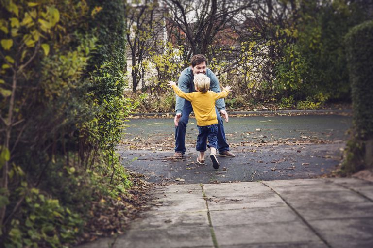 Little boy running to his Father