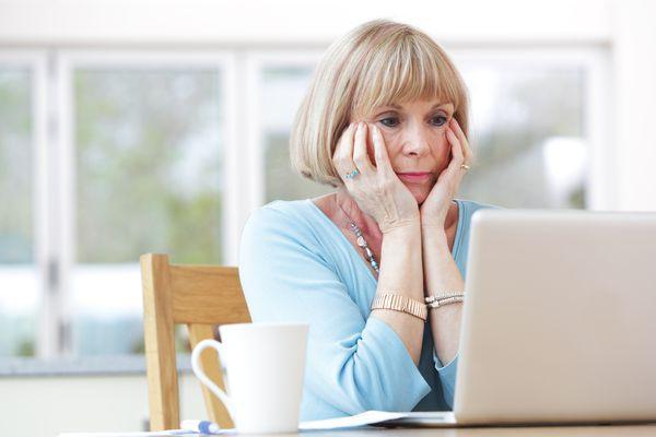 Mature woman looking at computer screen