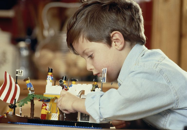 Picture of a young boy playing with LEGOs
