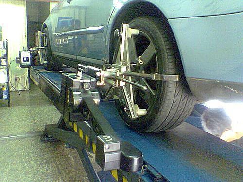 High tech wheel alignment machine.