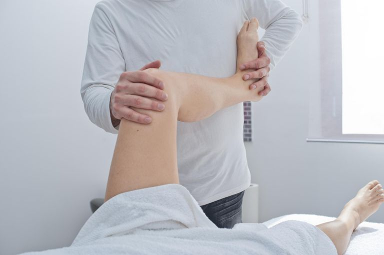 Person working with a physical therapist on their legs