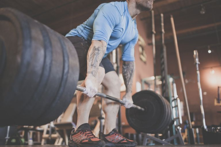 A man deadlifting significant weight at the gym