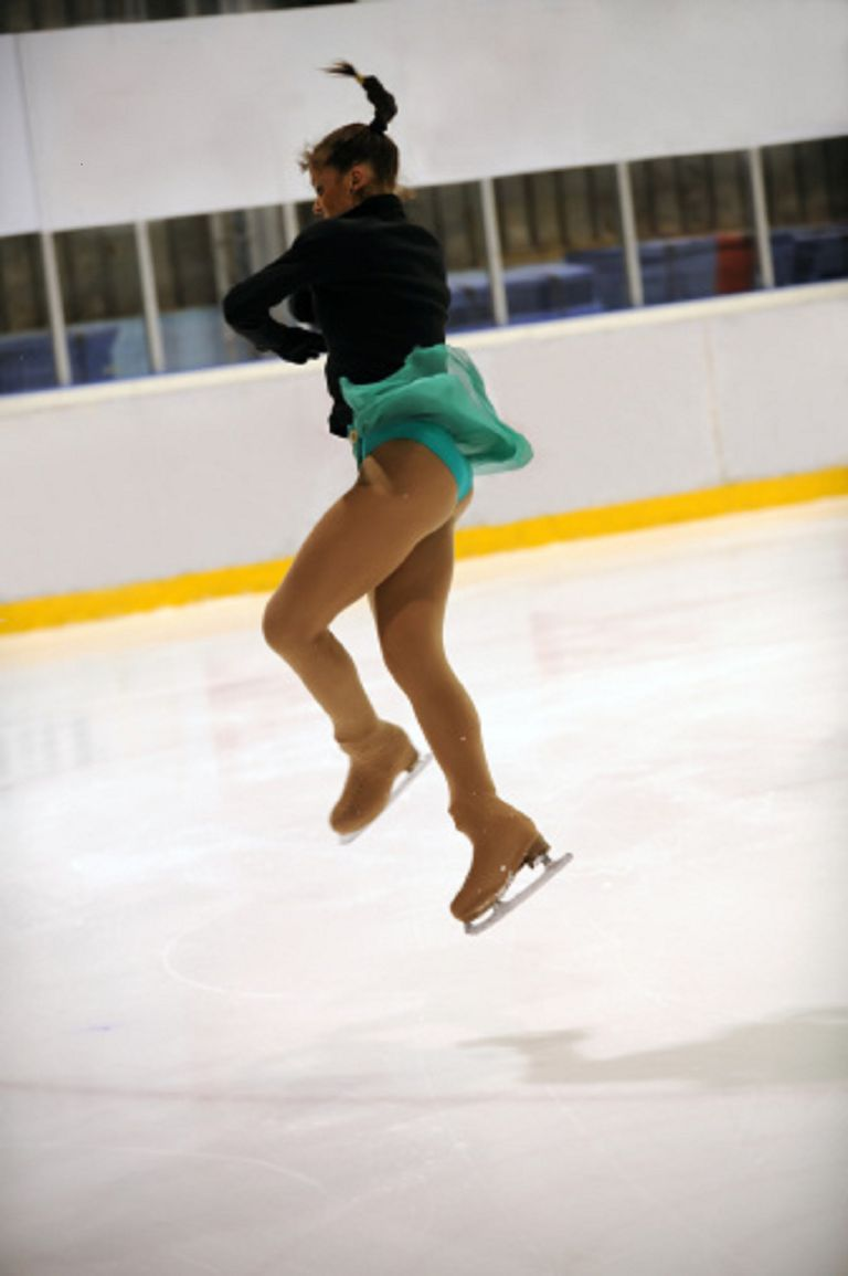 A Figure Skater Jumps