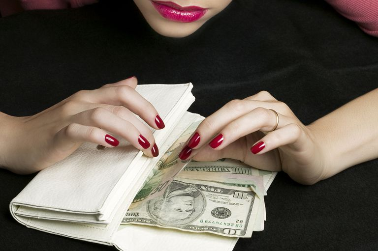 Woman Counting Money in Wallet