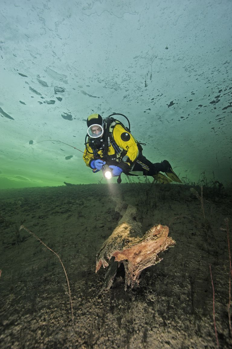 A drysuit diver under the ice.