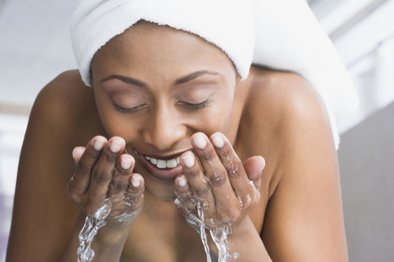 black woman washing face