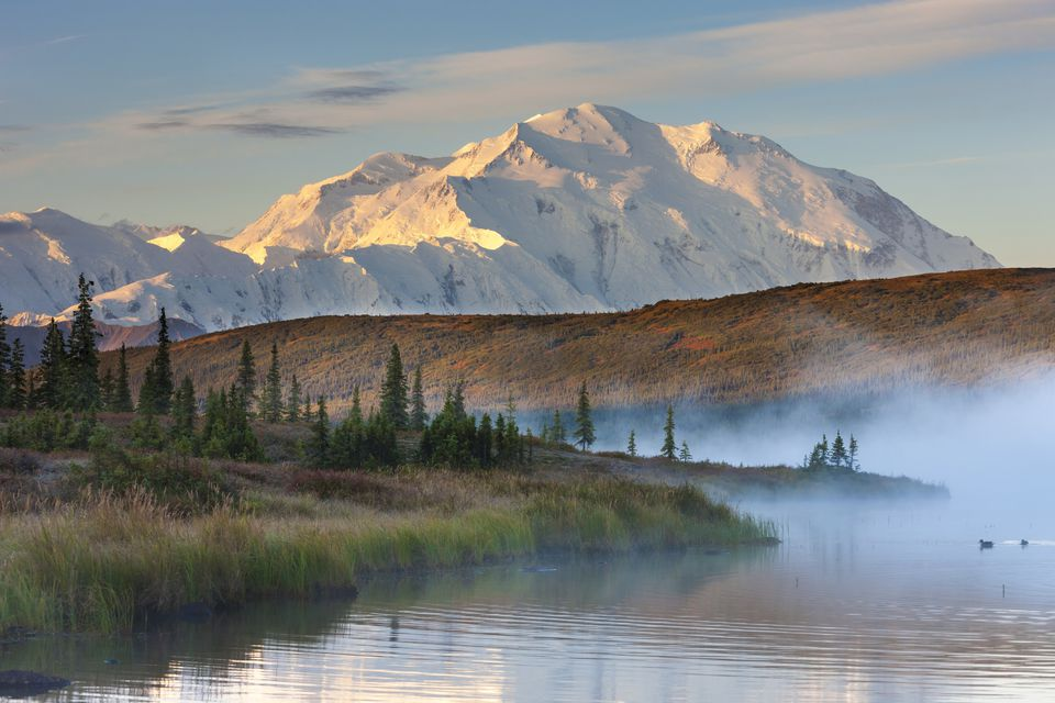 Morning Fog Over The Calm Waters Of Wonder Lake At Sunrise, Mt Mckinley Looms In The Distance