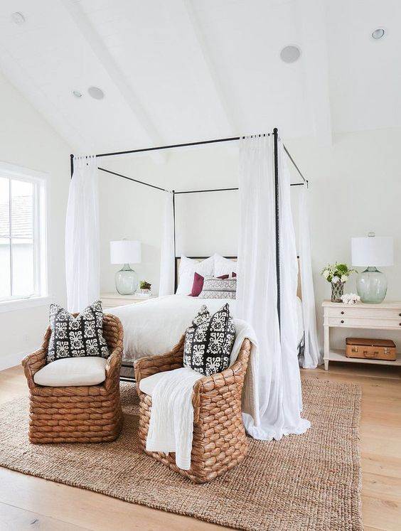 A warm bedroom with a canopy bed