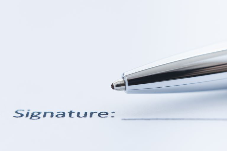 Image of a Pen Signing Paper