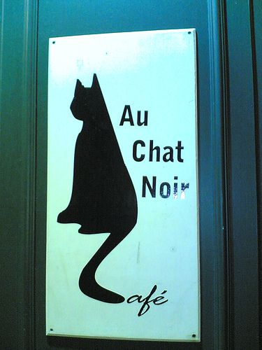 The Paris cafe Au Chat Noir's emblem is, you guessed it, a stylized black cat.