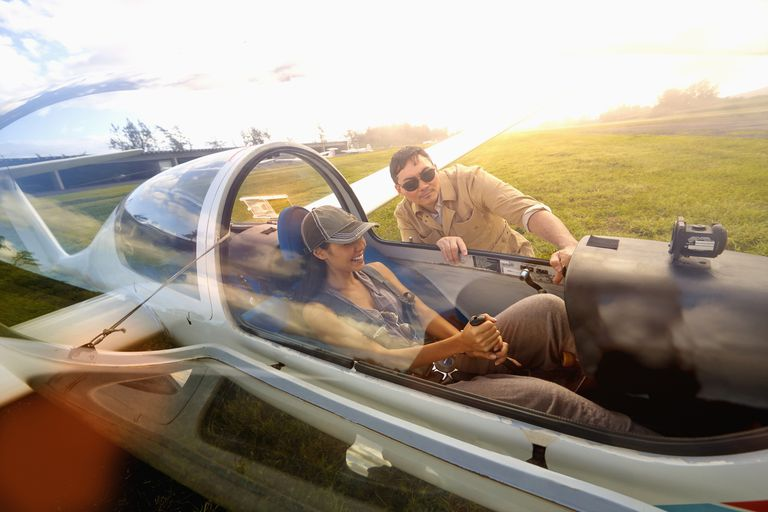 Woman taking flying lessons in glider airplane