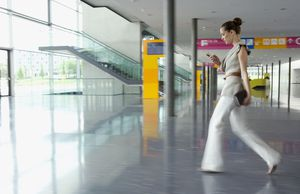 Businesswoman walking in convention center